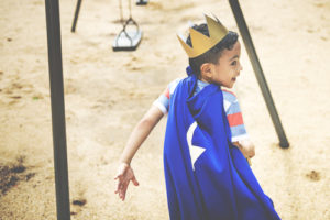 Kid in Superhero cape