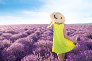 girl in yellow dress in field of purple flowers