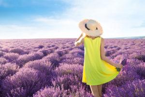 girl in yellow dress in field of purple flowers