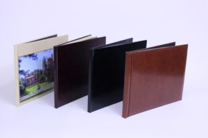 four photo books lined up with different style covers