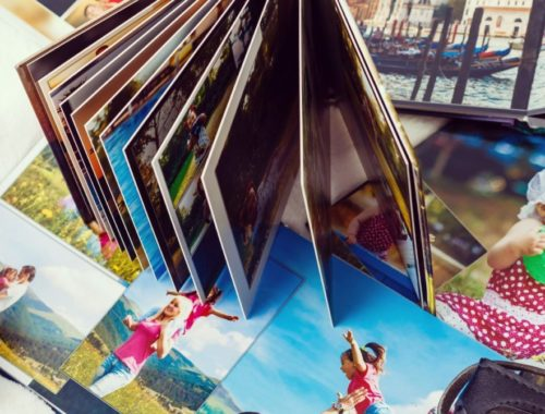 photo books spread out next to camera